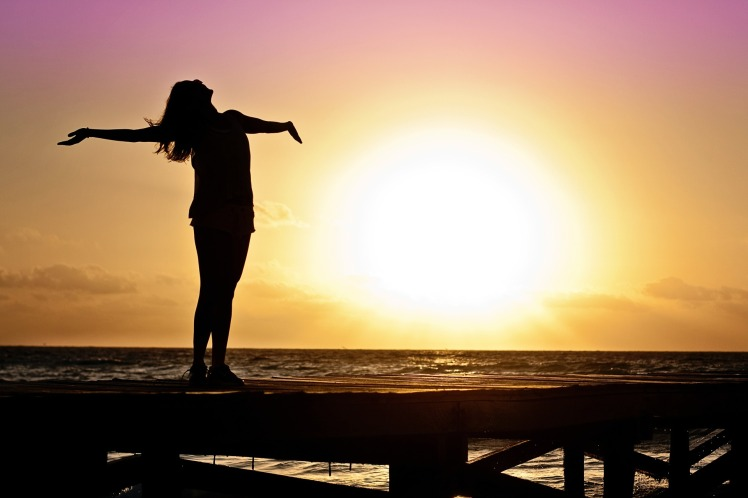 Photo of woman at sunset
